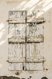 Old timber window in the scuffed wall Royalty Free Stock Photography