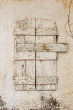 Old timber window in the scuffed wall Stock Photo