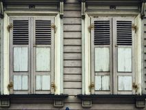 Old timber windows with shutters in riga latvia Royalty Free Stock Image
