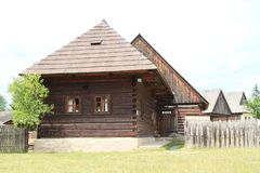 Old timbered houses in open-air museum. Old wooden village houses with shingles roofs in open-air museum Liptov Village Museum Pribylina in Slovakia Stock Image