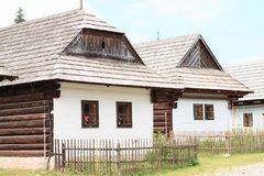 Old timbered houses in open-air museum. Old wooden village houses with shingles roofs in open-air museum Liptov Village Museum Pribylina in Slovakia Stock Images