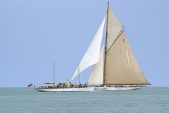 Old Time. And historic sailboat crossing an old motor boat during a regatta Royalty Free Stock Images