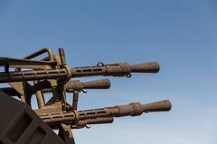 Old Time Anti Aircraft Machine Gun. Quadruple anti-aircraft machine gun, 14.5 mm caliber. The barrels of the anti-aircraft machine gun against the blue sky royalty free stock image
