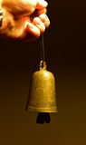 Old time bell in hand stock photos