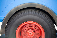 Old time blue bus wheel close-up. Royalty Free Stock Photography