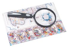 Old-time card and magnifying glass Royalty Free Stock Image