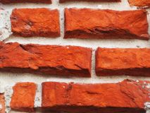 Old time-cut bricks in the wall. Old time cut bricks in the wall bright orange color and background texture and clay baked Stock Images