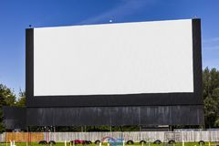 Old Time Drive-In Movie Theater with blank white screen for copy space or advertising I. Old Time Drive-In Movie Theater with blank white screen for copy space Royalty Free Stock Images