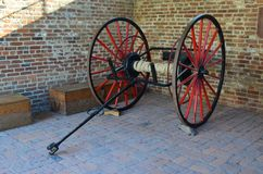 Old Time Fire Hose on Wheels. This is an old time fire hose that is on wheels. It has red spokes Royalty Free Stock Images