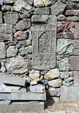 Old-time headstone. Ancient armenian tombstone in the monastery stone wall Royalty Free Stock Photography