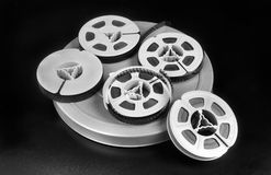 Old time 8mm film. Old time 8mm film and film canisters in black and white Royalty Free Stock Photos