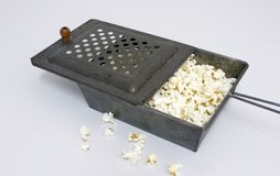 Old Time Popper. An old antique popcorn popper full of popcorn Royalty Free Stock Photos