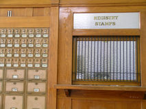 Old Time Post Office. Barred window and post office boxes Stock Photo
