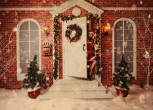 Old time postcard with beautiful attractive woman in xmas. Theme outdoor Stock Images