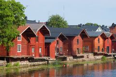 Old-time red wooden barns on the Porvonjoki river, July afternoon. Porvoo, Finland. Old-time red wooden barns on the Porvonjoki river on a sunny July afternoon royalty free stock images