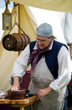 Old time reenactors and tools Stock Photos