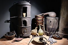 Old time room. Old room with boiller, coal, punnet, dustp and flask stock photo