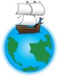 Old time sailing ship on globe Royalty Free Stock Image