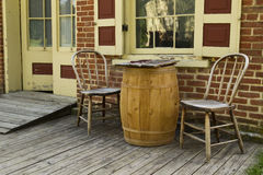 Old Time Scene. Old 1800's historic storefront scene with a wooden checkers game on an old wooden barrel next to wooden chairs Stock Images