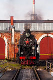 Old time steam engine locomotive. An old time steam engine locomotive in the depot Stock Image