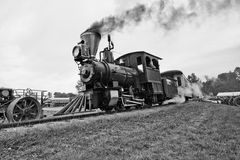 Old Time Vintage Steam Train Locomotive. Old time steam train vintage locomotive. Black and white image of an antique from an era gone by royalty free stock photos