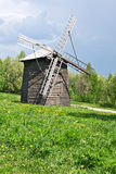 Old-time wooden windmill. On glade Royalty Free Stock Images