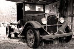 Old timer 2. Rusty old car in the barn Royalty Free Stock Photography