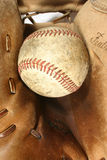 Old timer. A 55 plus year old glove still has the stuff to catch that equally old looking baseball Stock Image