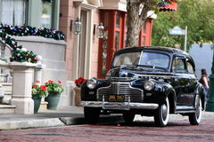 Old timer. A beautiful oldtimer standing in the streets of a city in the USA waiting to be driven around by its proud owners Stock Image