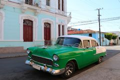 Old-timer car in front of colonial house in Cienfuegos, Cuba royalty free stock photo