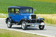 Old timer car. LANDSBERG, GERMANY - JULY 13: Oldtimer rally for at least 80 years old antique cars with Chevrolet Sedan AD Universal, built at year 1930, photo Stock Photos