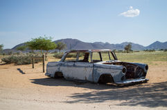 Old Timer Car Wreck in Front of a Desert Landscape with Mountain Royalty Free Stock Photos