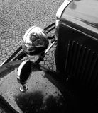 Old-timer. Front part with headlight and mirror Royalty Free Stock Photos