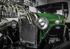 Old timer in garage. Wating driver for one ride on sunny day Royalty Free Stock Photo