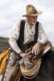 Old Timer Western Cowboy Roper. Old western cowboy rests along the trail on his horse royalty free stock photography