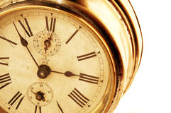 Old times. Vintage alarm clock closeup on white background Royalty Free Stock Image