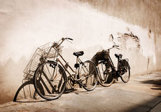 Old times. Italian old-style bicycles leaning against a wall in the historical centre of Parma Royalty Free Stock Photo
