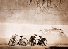 Old times. Italian old-style bicycles leaning against a wall in the historical centre of Parma Stock Images