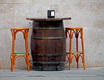 Old times table made of barrel and two stools. Spain Stock Photos