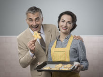 Old timey woman serving home made cookies royalty free stock photography
