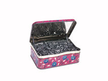 An old tin box full of Shoe nails. A tin box full of Shoe nails. Ajar Stock Images