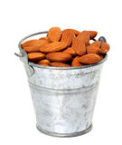 Old tin bucket with almonds Royalty Free Stock Photos