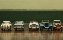 Old tin car. Old tin toy car on old wooden floor Stock Photo