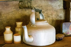 Old tin kettle and earthenware pots and jugs Royalty Free Stock Image