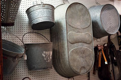 Old tin metal buckets and tubs. Country general stores carry many vintage utility tools and products for farmers and ranchers. These types of items are used for Stock Photo