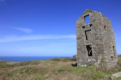Old Tin Mine Cornwall England. Old derelict Tin Mine in fields near the Coast in South Cornwall England Stock Photography