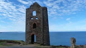 Old Tin Mine remains on cliffs in Cornwall UK Stock Photos