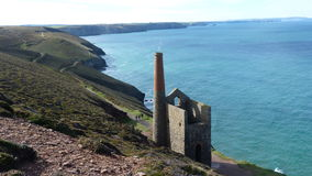 Old Tin Mine remains on cliffs in Cornwall UK Stock Images