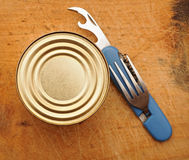 The old tin opener opening a can Stock Image