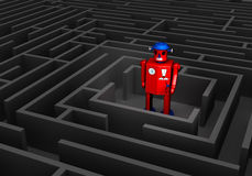 Old Tin Robot In Maze. A red, old fashioned tin toy robot stands at the center of a dark maze Stock Images